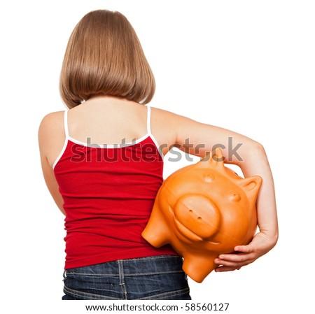Girl walking away with fat piggy bank, full of money - stock photo