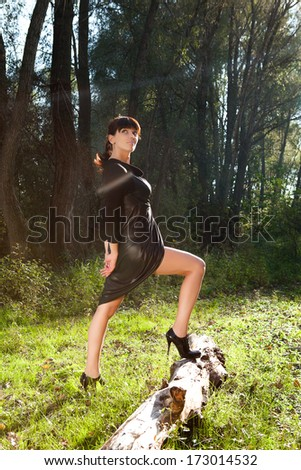 girl walking in a summer forest posing