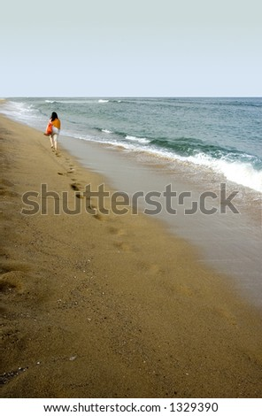 girl walking in an empty beach