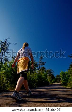 Girl walking in early morning - stock photo