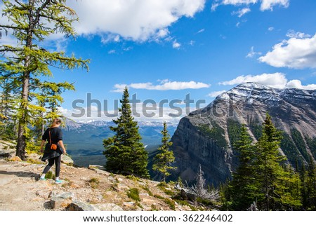 girl walking on a summit of a mountain in the banff national park in alberta canada close to lake louise - stock photo