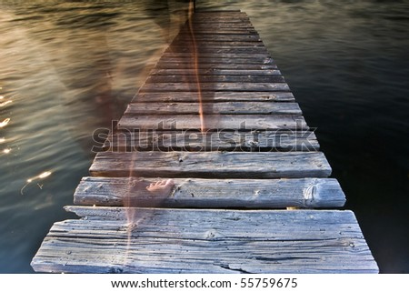 girl walking on the jetty - stock photo