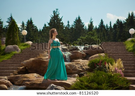girl walking through the woods and on rocks - stock photo