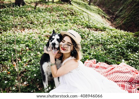 girl walking with her big dog outdoors - stock photo