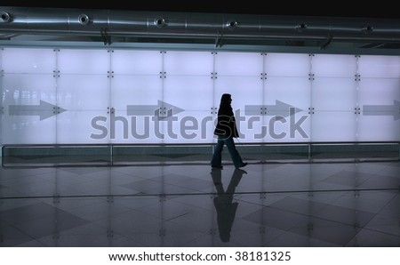 girl walking with reflection on the floor - stock photo