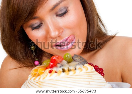 Girl wants to eat a whole cake. - stock photo