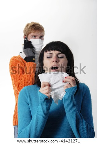 girl was ill of influenza, a man stands behind a mask, said by telephone, A(H1N1), on the  grey background. Focus is on the girl