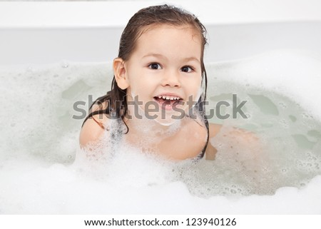 Girl washes in the bathroom - stock photo