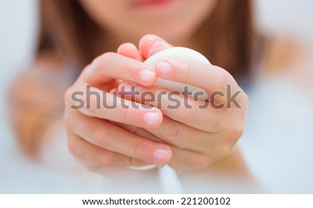 girl washing her hands with soap. close-up
