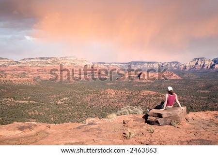 Girl watching Sedona Sunset - stock photo