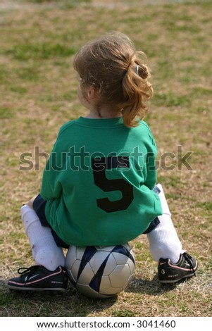 Girl watching the soccer game - stock photo