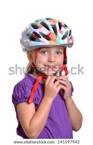 girl wearing a bicycle helmet - stock photo