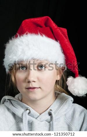 Girl wearing a santa hat - stock photo