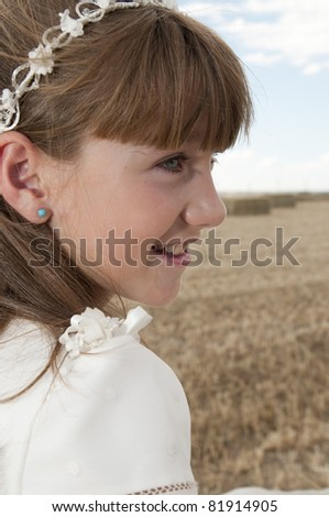 girl wearing first communion dress