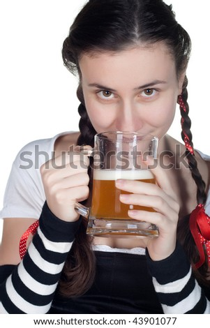 girl wearing in a traditional german dirndl costume with a beer mug