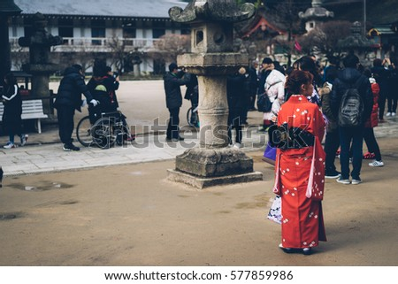 Girl wearing Japanese traditional outfit called Kimono in Dazaifu Tenmangu, Fukuoka, Japan. 23rd, Jan. 2017,