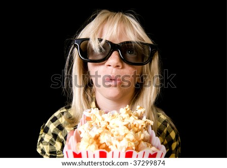 Girl Wearing New Style 3-D Glasses in a Movie Theater - stock photo