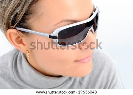 girl wearing sunglasses against white - stock photo