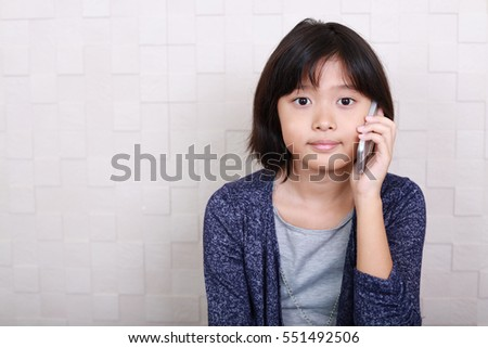 Girl who is talking on a smart phone