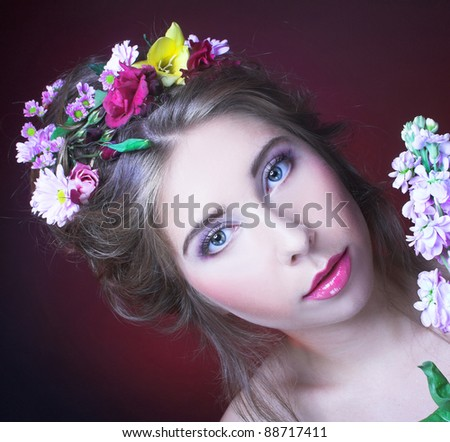 Girl wiht flowers in her hair and in her hands