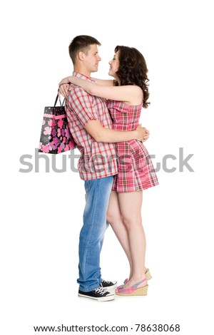 Girl with a bag hugs your favorite guy. - stock photo
