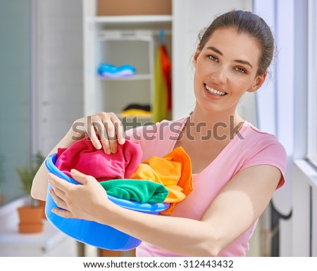 Girl with a basin full of laundry - stock photo