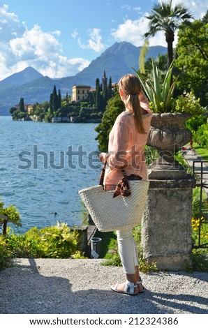Girl with a basket bag at the Como lake, Italy - stock photo