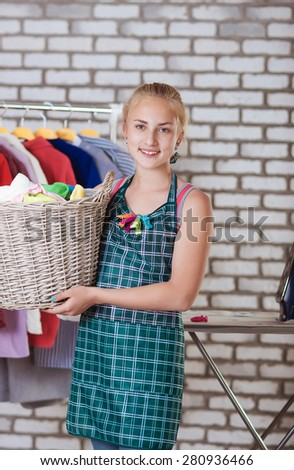 Girl with a basket of clothes