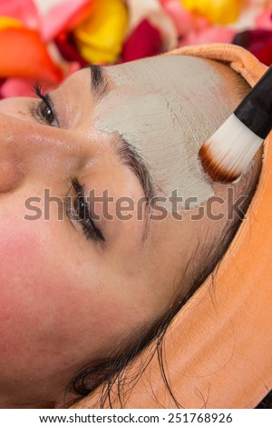 Girl with a beautician at spa salon. Beautician performs cosmetic procedures.applying cosmetic . Cosmetology, facial, beauty - The concept of facial skin care. Article about cosmetology.