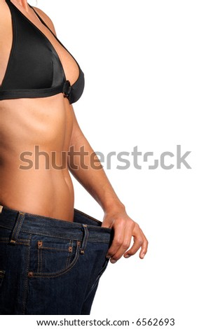 Girl with a bikini and belly with big jeans showing weight loss. - stock photo