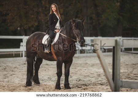 girl with a black horse - stock photo