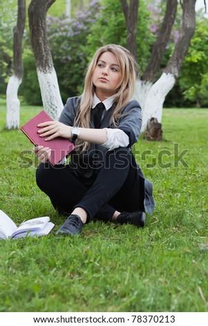 Girl with a book in a spring garden - stock photo