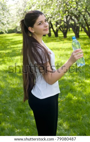 Girl with a bottle of water - stock photo