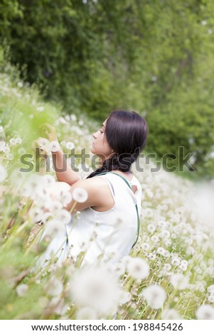 Girl with a bouquet of dandelions