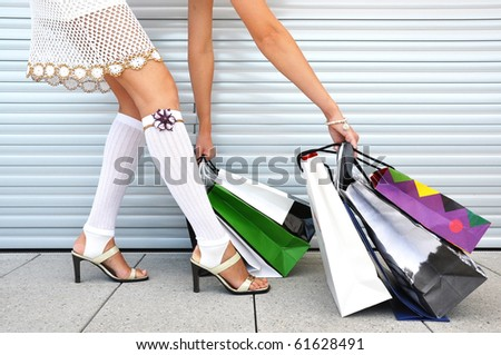 Girl with a bunch of shopping bags - stock photo