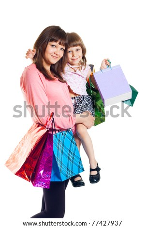 Girl with a child with shopping, white background - stock photo
