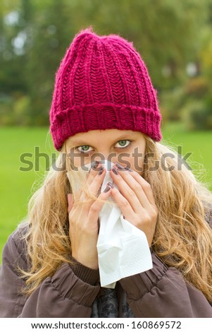 Girl with a cold - stock photo