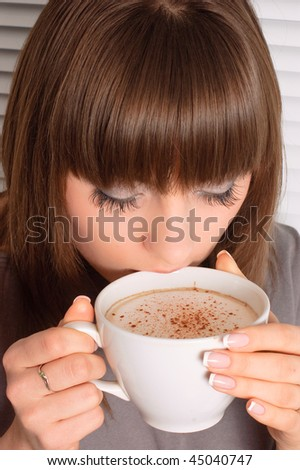 girl with a cup of cappuccino - stock photo