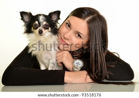 Girl with a dog a white background.decorative dog.chihuahua - stock photo
