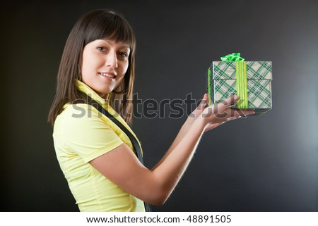 Girl with a gift against a dark background