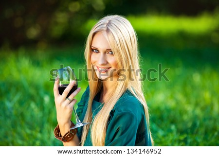 girl with a glass of wine outdoor picnic - stock photo