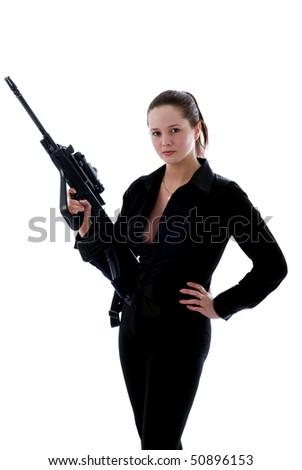 Girl with a gun. - stock photo
