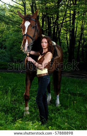 Girl with a horse. - stock photo