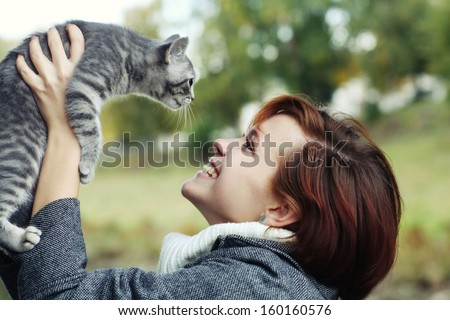 girl with a kitten - stock photo