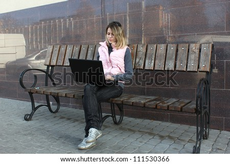 girl with a laptop in the park