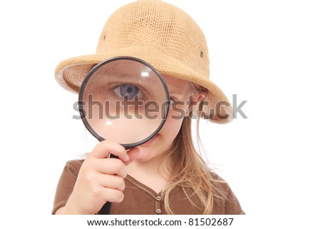 Girl with a magnifying glass and safari hat - stock photo