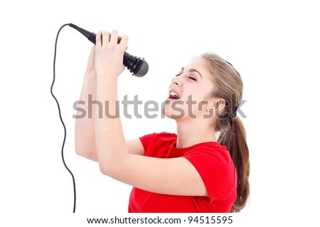 Girl with a microphone singing over white background - stock photo