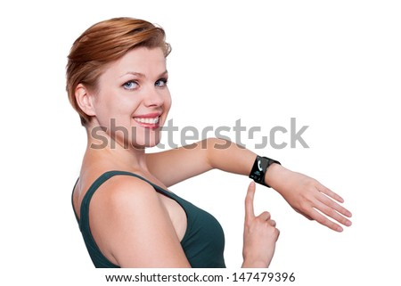 Girl with a modern Internet Smart Watch isolated on white. On the screen you can see a symbol of a call. All Texts, Icons, Interfaces of the Smart Watch where created  by myself. - stock photo