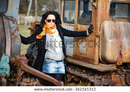 Girl with a old tractors. - stock photo