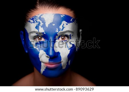 Girl with a painted map of World on his face. Closeup. - stock photo